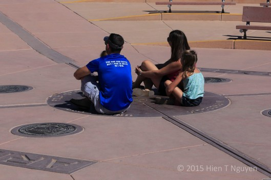 Family posing at Four Corners Monument.